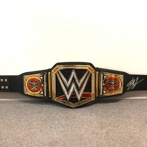 Photo of Brock Lesnar SIGNED WWE Championship Replica Title Belt