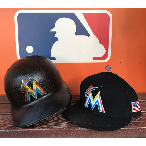 Photo of Game-Used Hat & Helmet: Miguel Rojas - Size 7 3/8