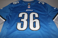 LIONS - DWAYNE WASHINGTON SIGNED LIONS REPLICA JERSEY - SIZE L