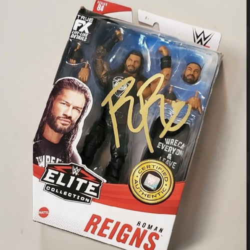 Photo of Roman Reigns SIGNED WWE Elite Series 84 Action Figure