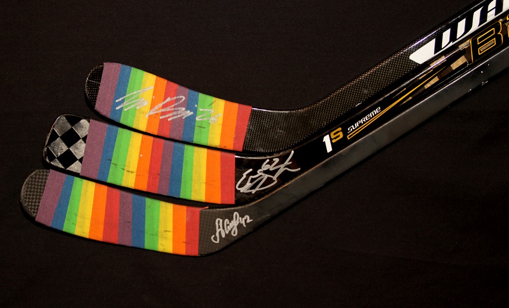 Collection Of Three Autographed 2016-17 Edmonton Oilers You Can Play Night Pre-Game Warm Up Used Sticks With Pride Tape Including Eric Gryba, Iiro Pakarinen & Anton Slepyshev