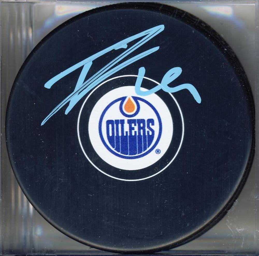 Leon Draisaitl Edmonton Oilers Autographed Hockey Puck *Autograph Slightly Streaky*