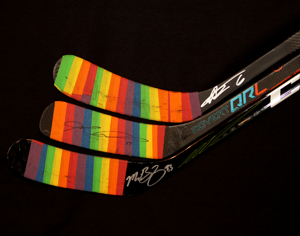 Collection Of Three Autographed 2016-17 Edmonton Oilers You Can Play Night Pre-Game Warm Up Used Sticks With Pride Tape Including Adam Larsson, Mark Letestu & Matthew Benning