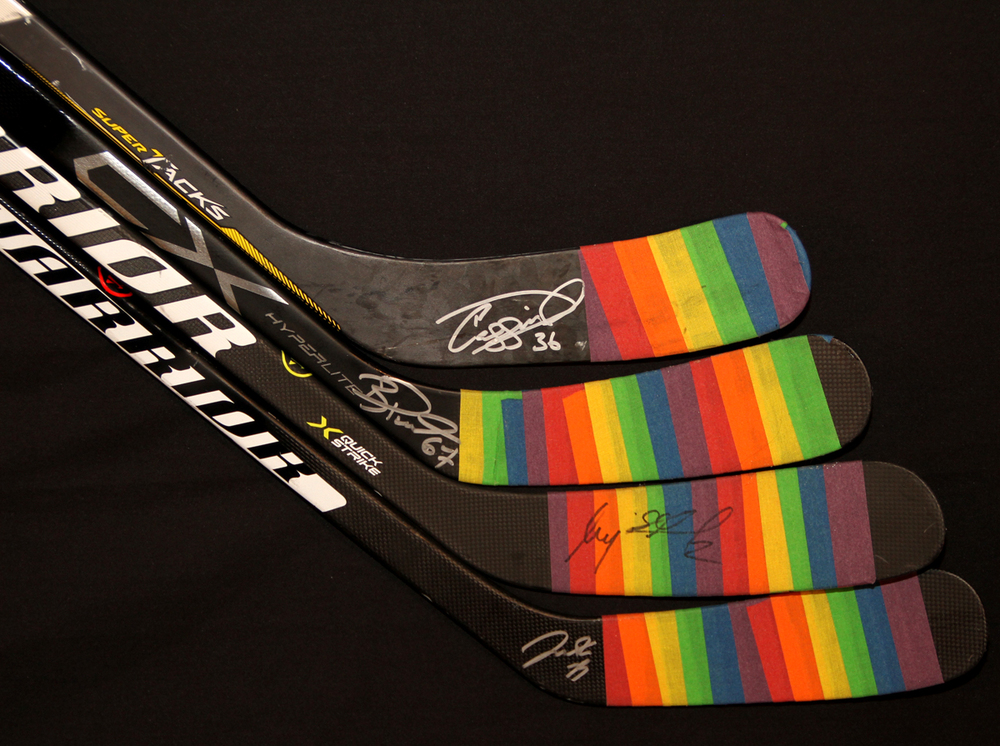 Collection Of Four Autographed 2016-17 Edmonton Oilers You Can Play Night Team Issued Sticks With Pride Tape (NOT USED) Including Darnell Nurse, Andrej Sekera, Benoit Pouliot & Drake Caggiula