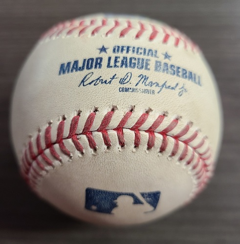 Photo of Authenticated Game Used Baseball: Foul by Aaron Hicks against Hyun-Jin Ryu (Sep 24, 2020 vs NYY). Top 1. Game played in Buffalo. Blue Jays Clinched Postseason Berth in Game.