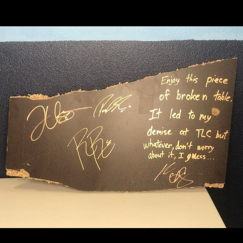 Roman Reigns, Paul Heyman, Jey Uso, and Kevin Owens SIGNED and USED Table Piece from TLC 2020