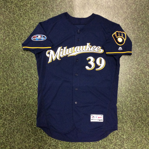 Photo of Corbin Burnes 2018 Game-Used Postseason Jersey - NLCS Games 3 & 4 - 2.0 IP, 0 H, 0 R, 0 BB, 3 SO (NLCS Game 4)