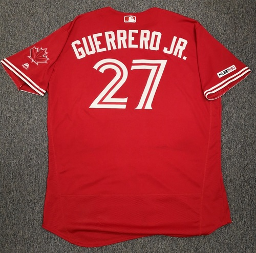 Photo of Authenticated Game Used Canada Day Jersey - #27 Vladimir Guerrero Jr. (July 1, 19: 1-for-3 with 1 Double, 3 Runs and 2 Walks). Size 52