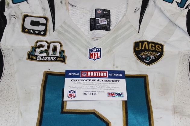 NFL Auction   BCA - PAUL POSLUSZNY GAME USED JAGUARS JERSEY 10/5/14
