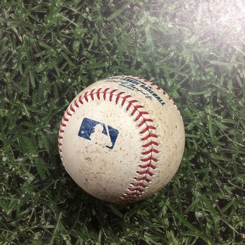 Photo of Game-Used Baseball CLE@MIL  05/08/18 - Corey Kluber - Lorenzo Cain: Single