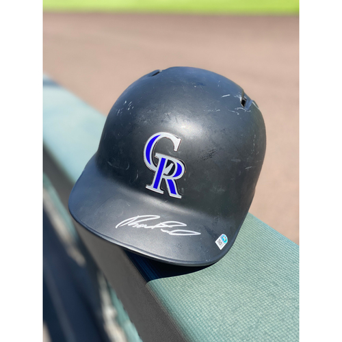 Photo of Colorado Rockies Autographed Helmet: Raimel Tapia - Size 7 1/4