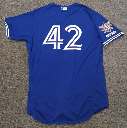 Photo of Charity Auction - Authenticated Game Used #42 Jersey - Justin Smoak (April 15, 19: 2-for-3 with 1 Double, 1 Run, 1 RBI and 1 Walk). Size 48