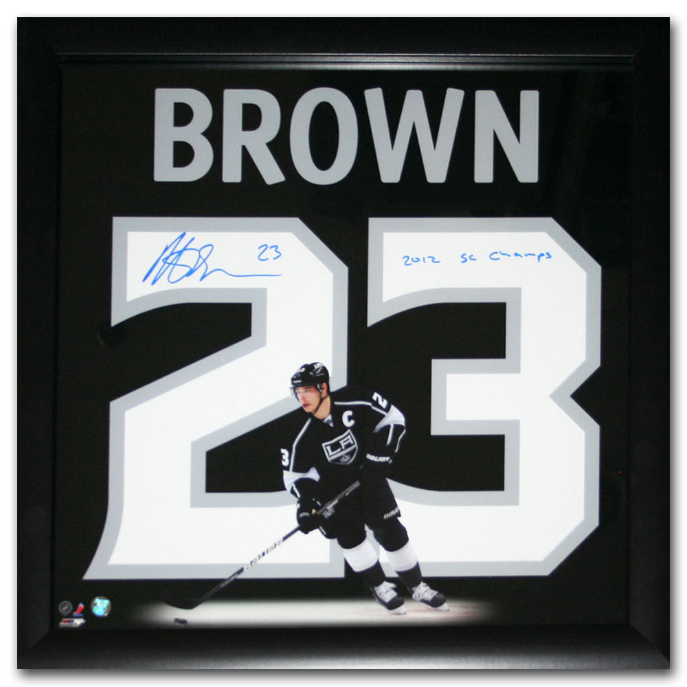 Dustin Brown Autographed Los Angeles Kings 20X20 Uniframe Display w/2012 SC CHAMPS inscription
