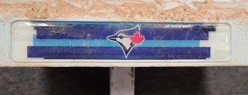 Photo of Authenticated Game Used Base: 2nd Base for Innings 7 to 9 (Sep 24, 2020). Blue Jays clinched playoff berth with base in place.