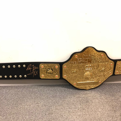 Photo of Ric Flair SIGNED WCW Heavyweight Championship Replica Title