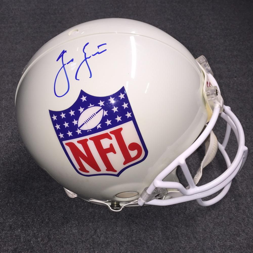 NFL - Cowboys Jason Garrett signed older NFL shield logo proline helmet (Yellow Fading on helmet and pen markings on other side of helmet/signature)