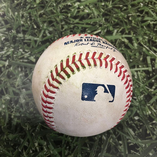Photo of Game-Used Baseball ATL@MIL 10/09/21 (NLDS Game 2) - Brandon Woodruff - Ozzie Albies: RBI Double (Albies' 8th Career Postseason RBI, 1st of 2021)