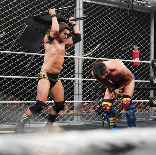 Photo of Adam Cole & Johnny Gargano USED & SIGNED Steel Chair (NXT TakeOver: Toronto - 08/10/19)