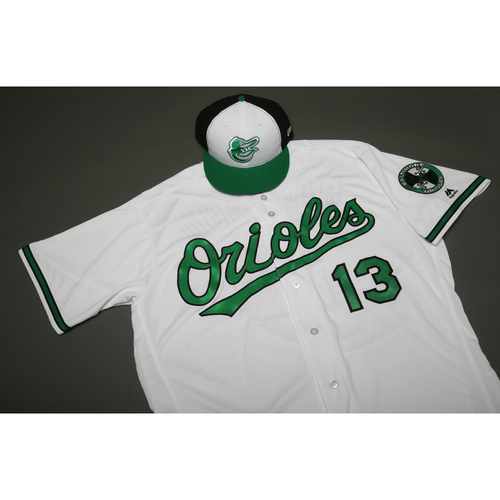 Photo of Adam Jones Autographed, Game-Worn Earth Day Jersey and Cap