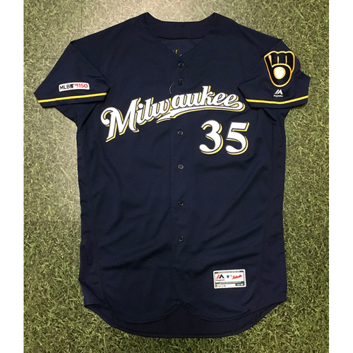 Photo of Brent Suter 09/21/19 Game-Used Navy Ball&Glove Jersey - 2.0 IP, 1 H, 0 R, 0 BB, 1 SO (W, 3-0)