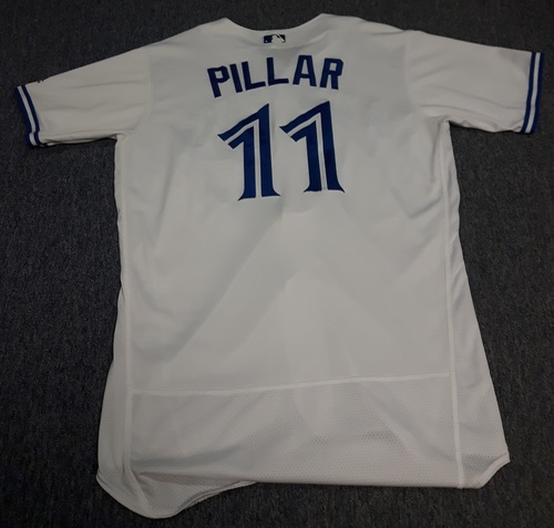 Photo of Authenticated Game Used Jersey - #11 Kevin Pillar: Diving Over the Head Catch (May 8, 2017). Size 44. Also used for Home Opener