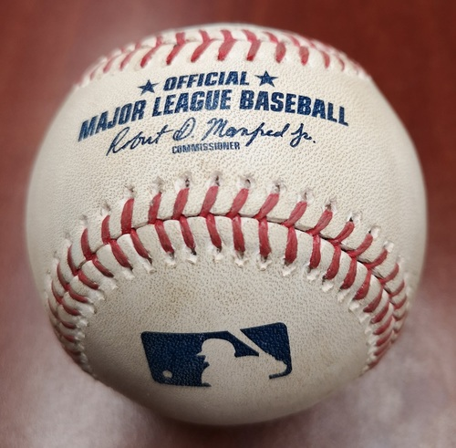 Photo of Authenticated Game Used Baseball - Mike Trout Hit by Pitch against Joe Biagini (June 18, 2019 vs LAA). Top 8.
