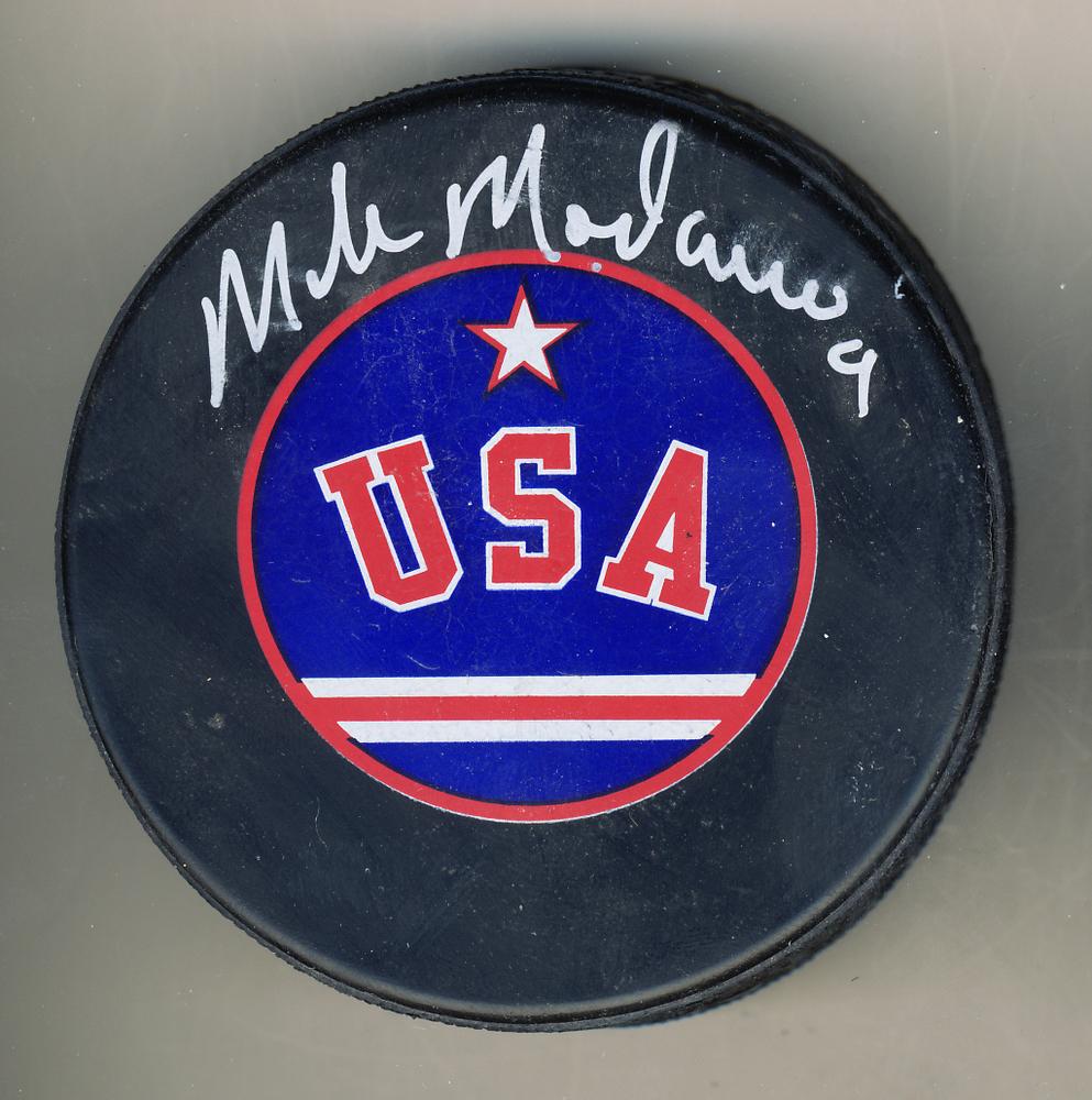 abb0d84d0b8 Mike Modano Team USA Autographed Hockey Puck  Autograph Slightly Smudged