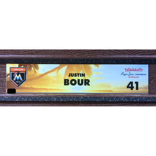 Photo of Justin Bour Game-Used Spring Training Locker Tag