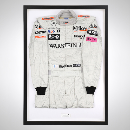 Photo of Mika Hakkinen 2001 Framed Race-worn Suit - McLaren