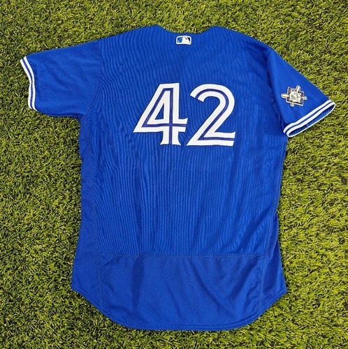 Photo of CHARITY AUCTION: Authenticated Game Used #42 Jersey: Rafael Dolis (Aug 28, 20: 1 IP, 1 Hit, 0 ER, 1 K. Winning Pitcher. 1st Win as a Blue Jay). Size 50.