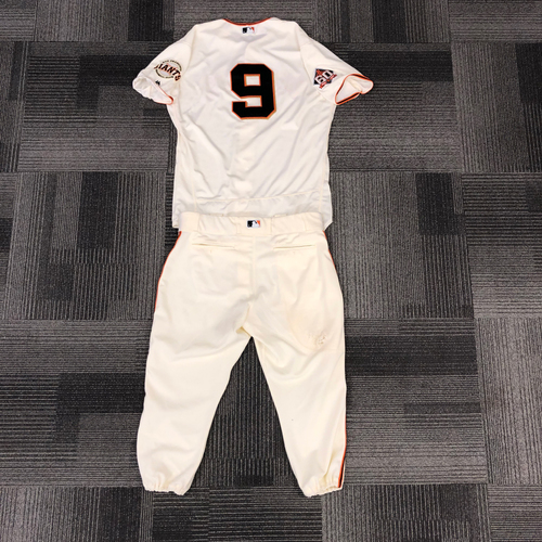 Photo of 2018 Game Used Home Cream Jersey & 2018 Team Issued Pants - #9 Brandon Belt - Jersey was worn on 4/4, 4/24, 5/14, 5/15, 5/16,5/17 & 5/20 - 7 HOME RUNS! - Size 48