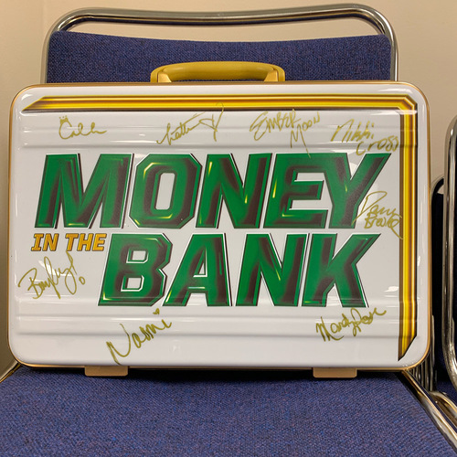 Photo of Autographed WWE Money In The Bank Women's Replica Briefcase (Signed by all 8 participants)