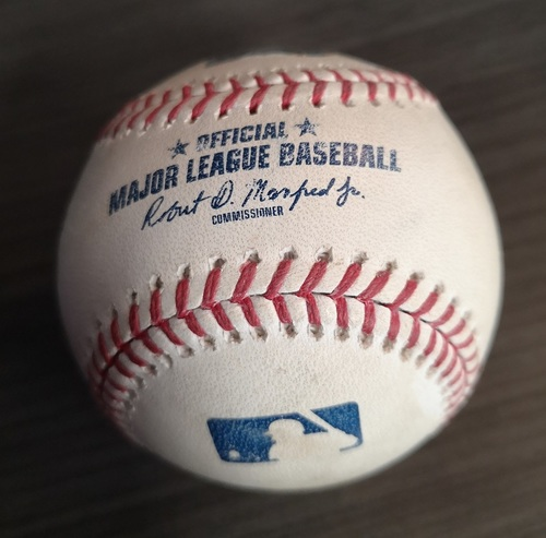 Photo of Authenticated Game Used Baseball - Single by Christian Yelich against Sam Gaviglio (Mar 25, 19 vs MIL. Spring Training in Montreal). Top 1.