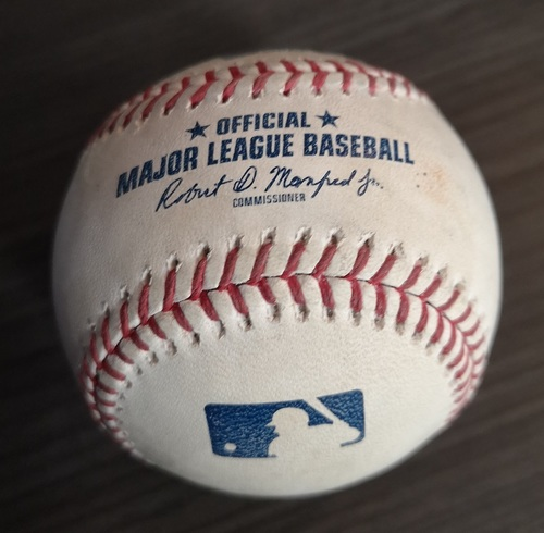 Photo of Authenticated Game Used Baseball - Single by Rafael Devers against Marcus Stroman (May 21, 19 vs BOS). Top 2.