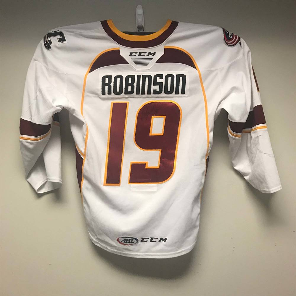 Cleveland Monsters Regular Season Jersey worn and signed by #19 Erik Robinson