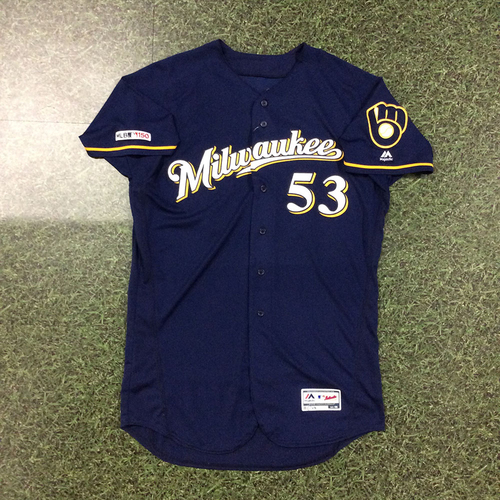 Photo of Brandon Woodruff 06/23/19 Game-Used Navy Ball & Glove Jersey - 7.0 IP, 7 H, 3 ER, 1 BB, Career-High 12 SO, Win (9-2)