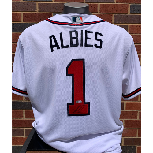 Photo of Ozzie Albies MLB Authenticated and Autographed Home Jersey with 150th Anniversary Patch