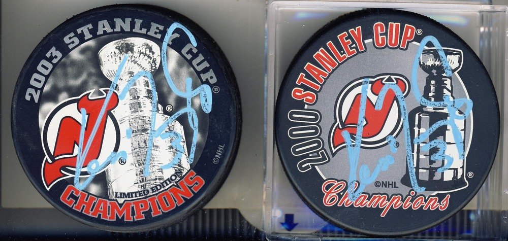 Lot of 2 Ken Daneyko New Jersey Devils Autographed Stanley Cup Pucks - 2000 & 2003 *Autographs Slightly Smudged*