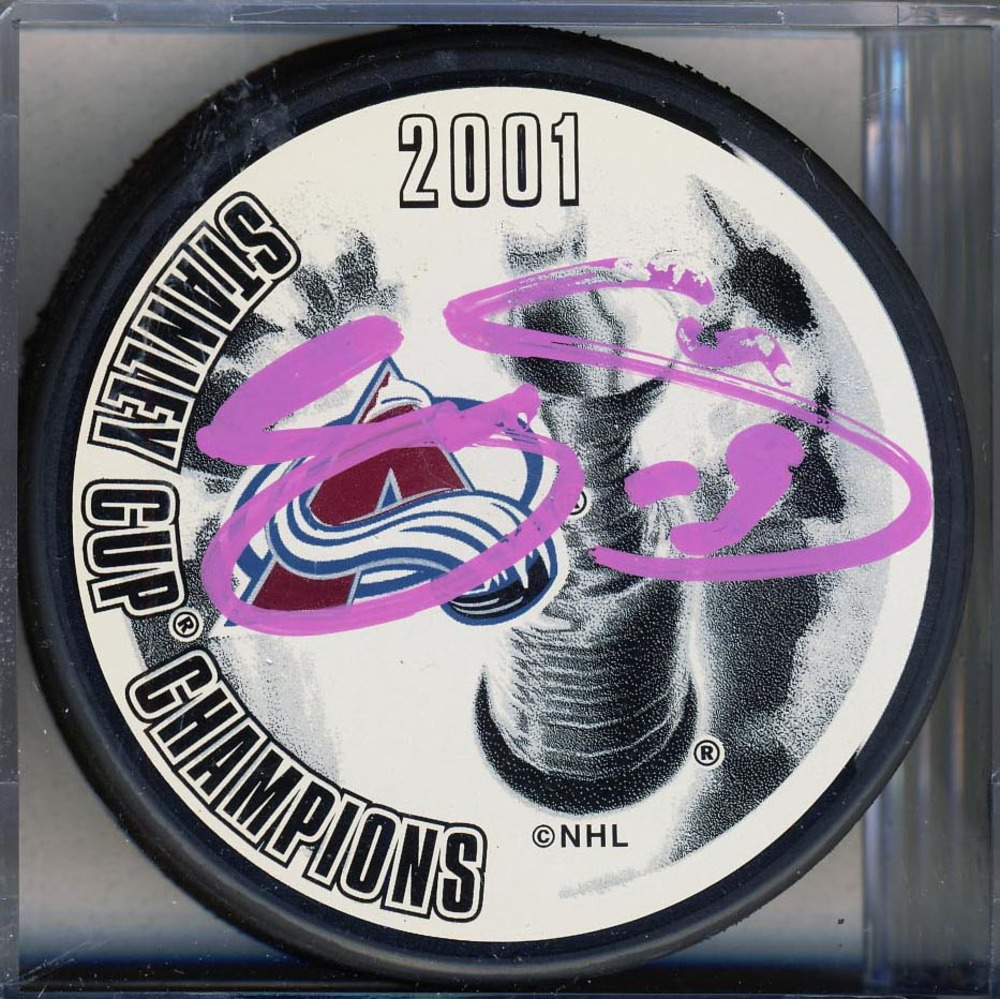 Joe Sakic Colorado Avalanche Autographed 2001 Stanley Cup Puck *Autograph Slightly Smudged*