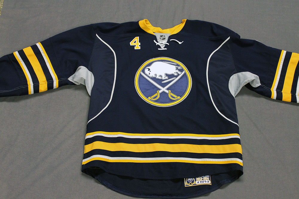 Jamie McBain Game Worn Buffalo Sabres Home Jersey.  Serial: 1171-2. Set 2 - Size 56.  2013-14 season.