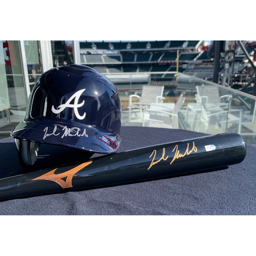 Photo of Nick Markakis Autographed Helmet and Bat Combo