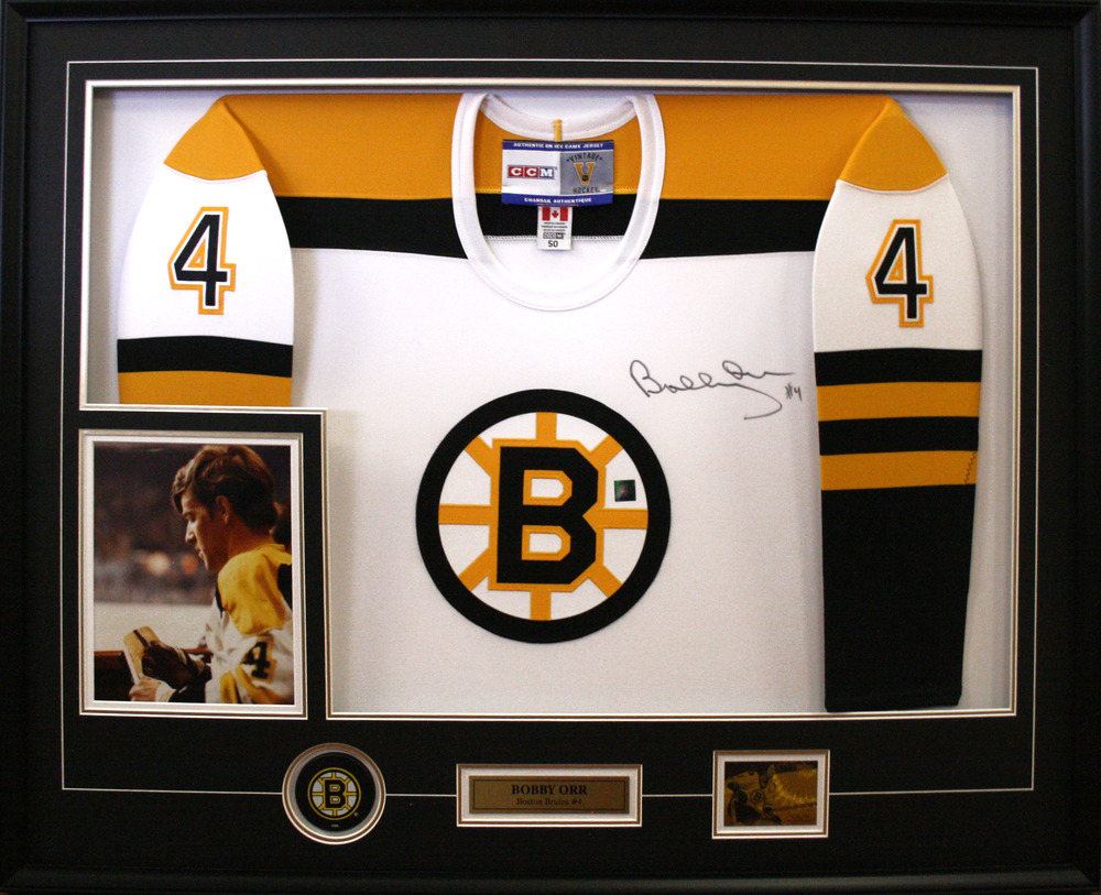 Bobby Orr - Signed  & Framed White Boston Bruins Jersey Featuring Boston Bruins Hockey Puck & Photo