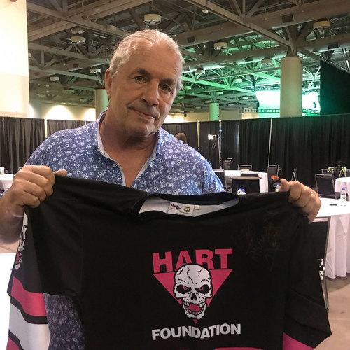 Photo of Bret Hart SIGNED Hart Foundation Hockey Jersey