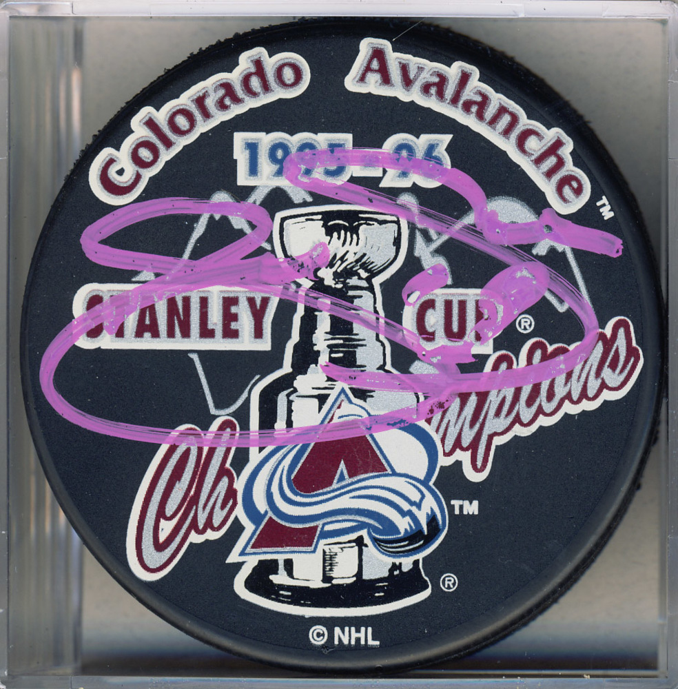 Joe Sakic Colorado Avalanche Autographed 1996 Stanley Cup Puck *Autograph Slightly Streaky*