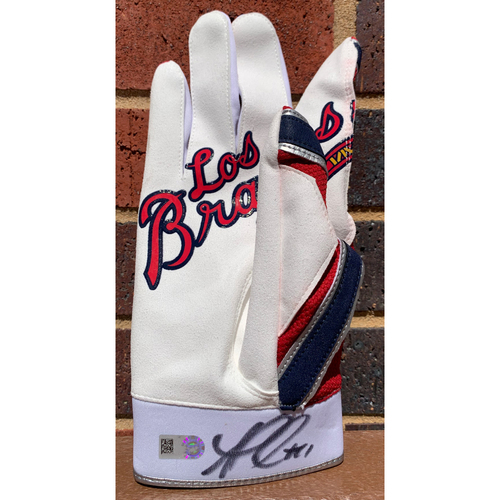 Photo of Ozzie Albies MLB Authenticated and Autographed Los Bravos Batting Glove