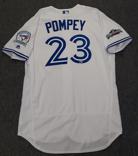 Photo of Authenticated Game Used 2016 Postseason Jersey - #23 Dalton Pompey (October 17: ALCS Game 3). Size 48.