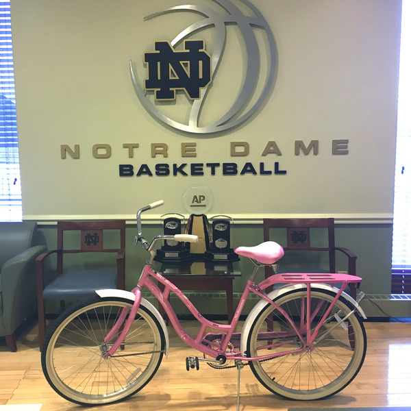 Photo of Notre Dame Women's Basketball Team Autographed Pink Huffy Bicycle