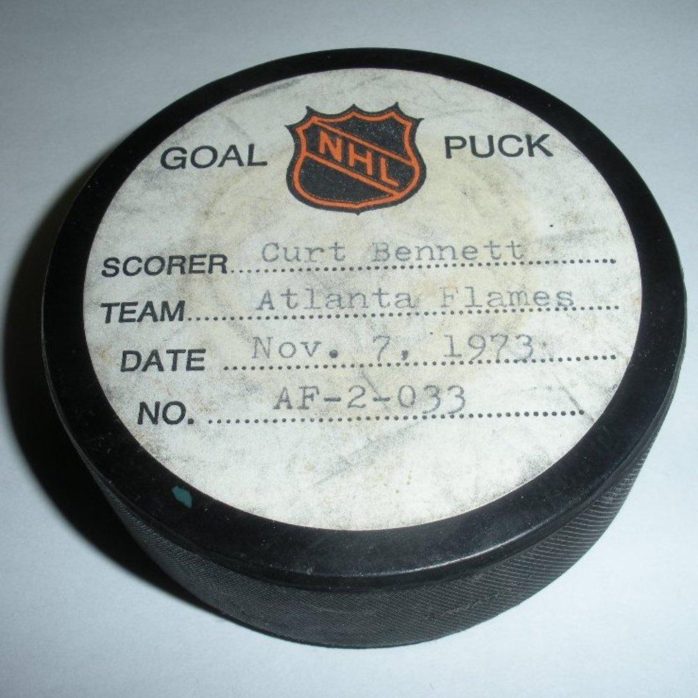 Curt Bennett - Atlanta Flames - Goal Puck - November 7, 1973 (Flames Logo)