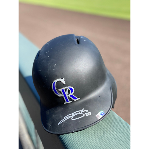 Photo of Colorado Rockies Autographed Helmet: Trevor Story Size 7 1/8