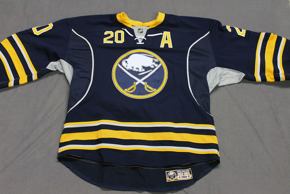 Henrik Tallinder Game Worn Buffalo Sabres Home Jersey.  Serial: 1169-2. Set 2 - Size 58.  2013-14 season.